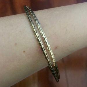 2 thin gold bracelets